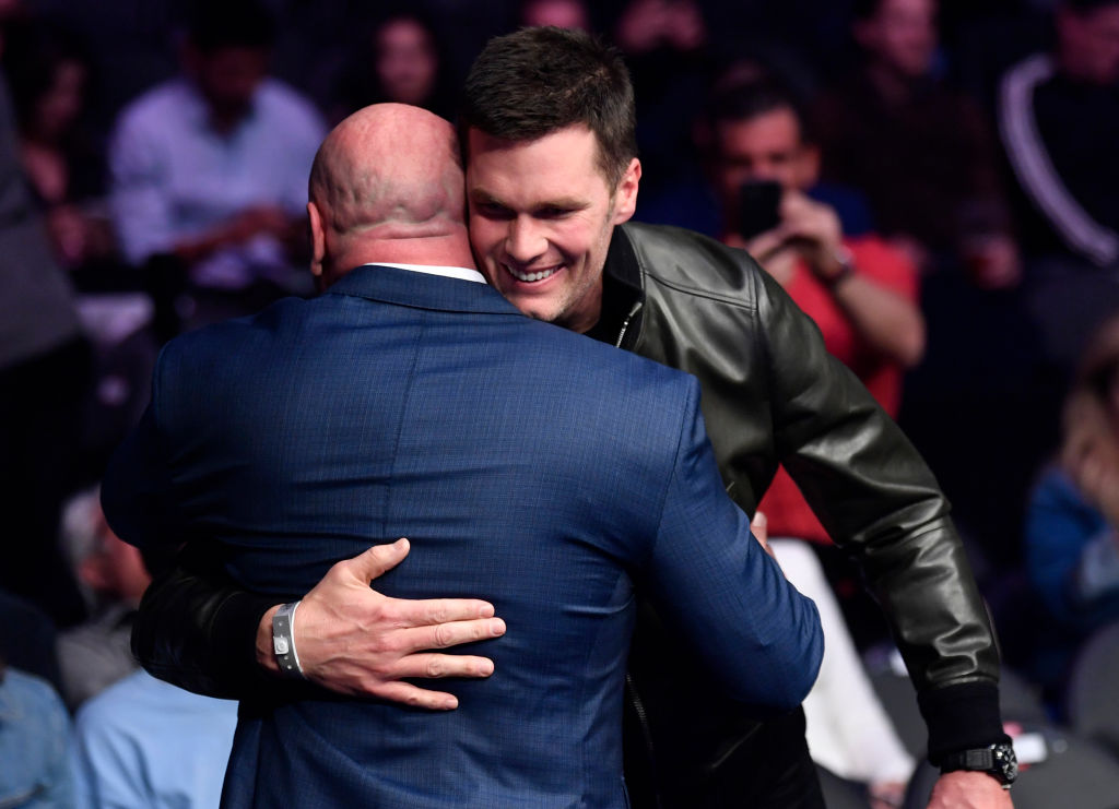 Tom Brady greets Dana White while attending the UFC 246