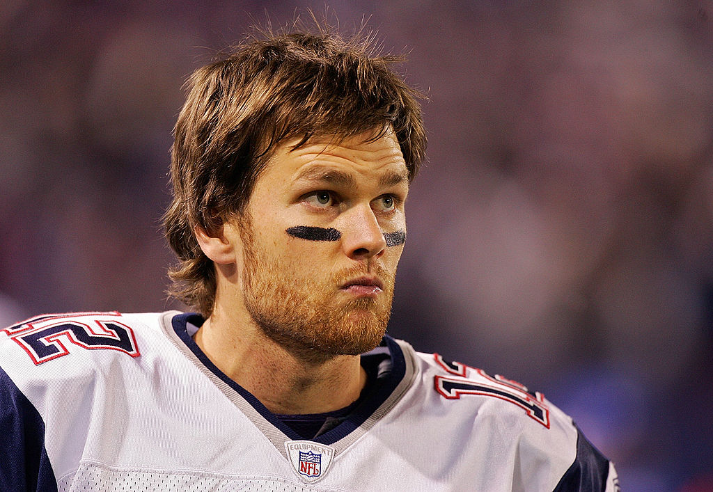 Tom Brady of the New England Patriots looks on from the sidelines in 2007