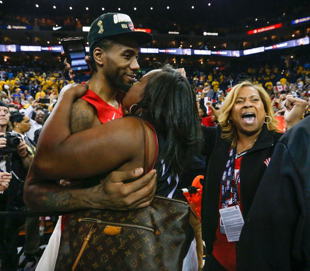 Toronto Raptors forward Kawhi Leonard celebrates with his family after a win