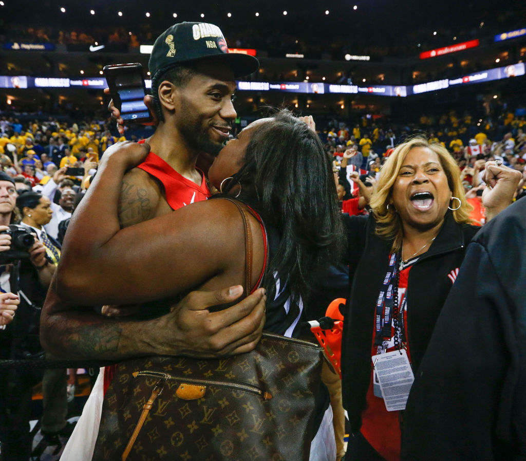 Toronto Raptors forward Kawhi Leonard celebrates with his family after a win