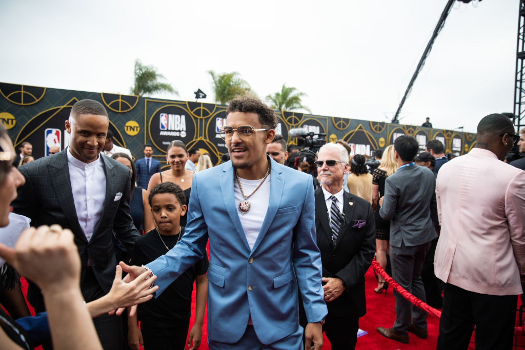 Trae Young high-fives fans at the NBA Awards in 2019