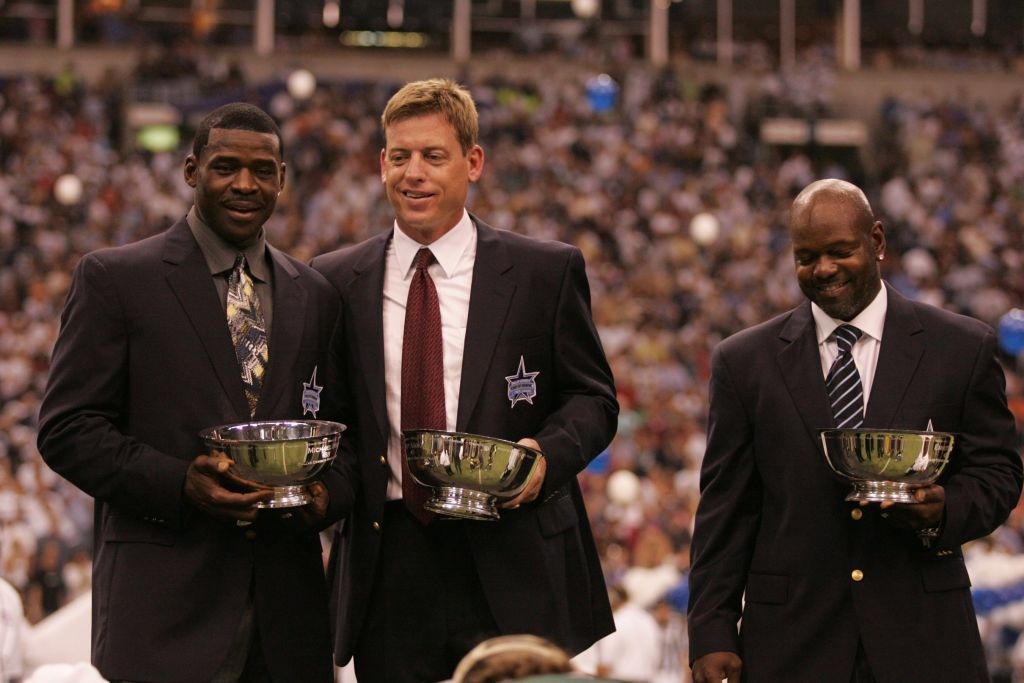 (L-R) Michael Irvin, Troy Aikman, and Emmitt Smith at the Ring of Honor ceremony during halftime of a Dallas Cowboys game