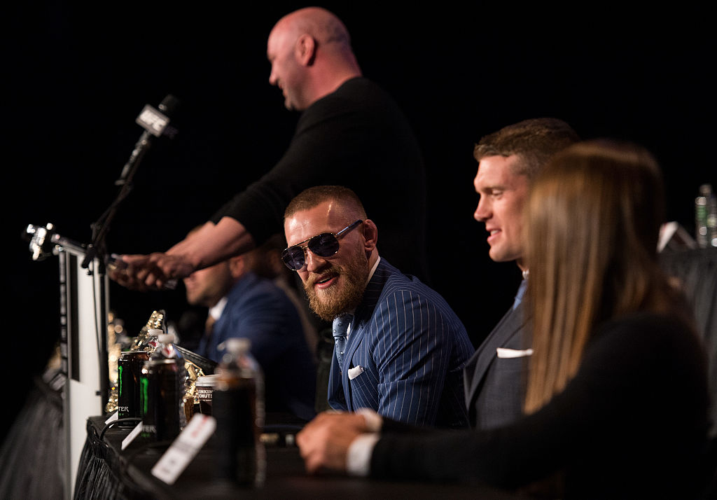 UFC featherweight champion Conor McGregor interacts with the media and fans during the UFC 205 press event