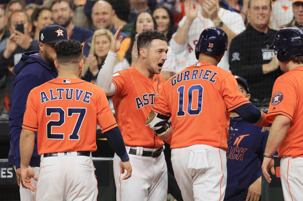 Yuli Gurriel of the Houston Astros is congratulated by his teammate Alex Bregman