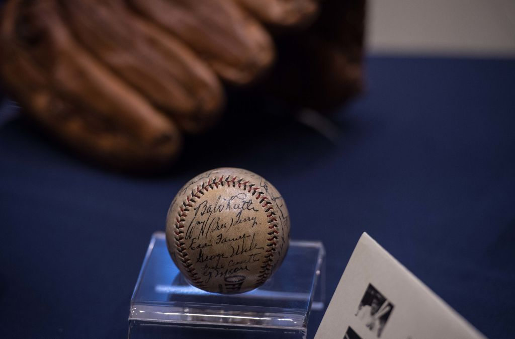 A baseball signed by Babe Ruth is displayed with other baseball memorabilia from the Smithsonian National Museum of American Historys collection