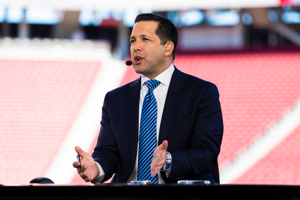 Adam Schefter talking on a television set