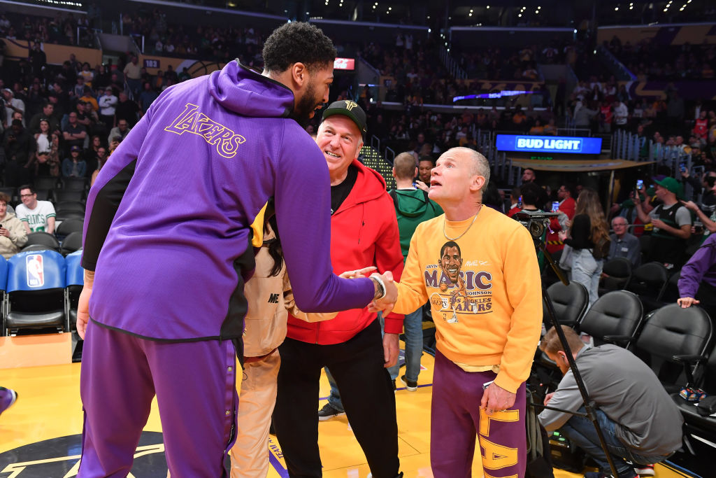 Anthony Davis shakes hands with Flea prior to a Lakers game