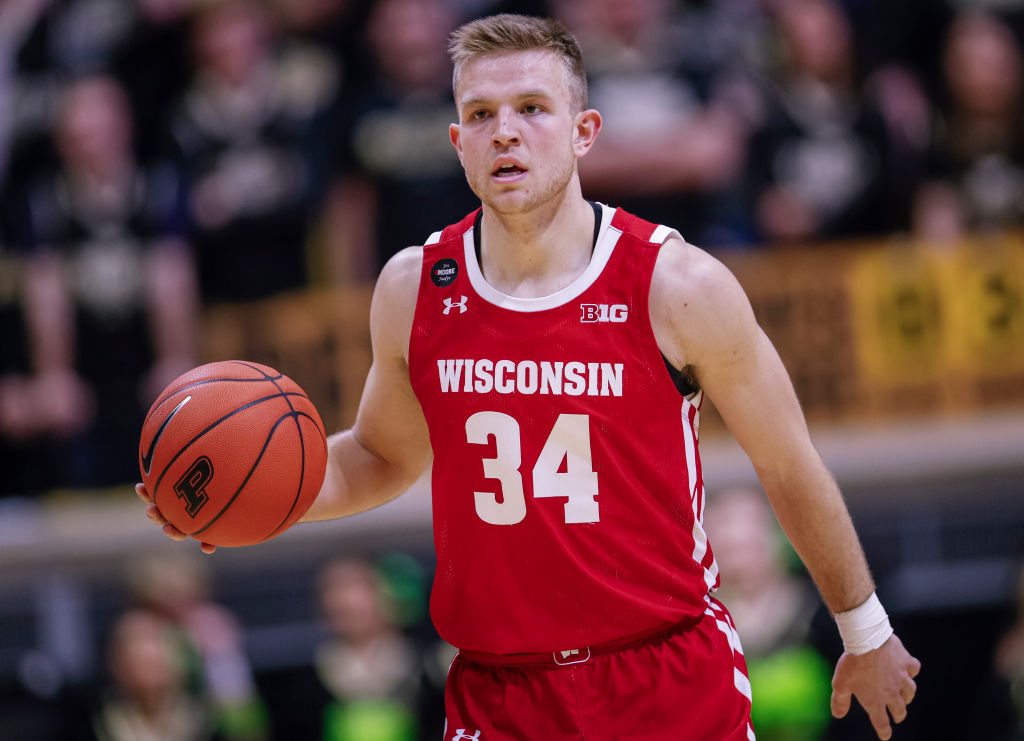 Brad Davison of the Wisconsin Badgers brings the ball up court