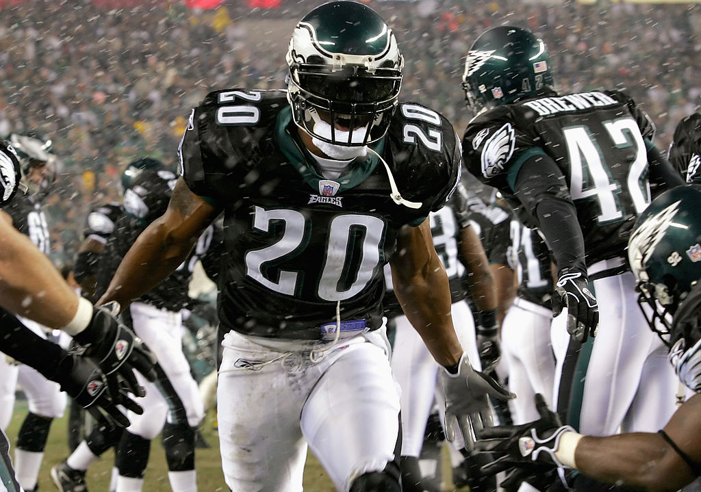 Brian Dawkins runs on to the field wearing a black visor