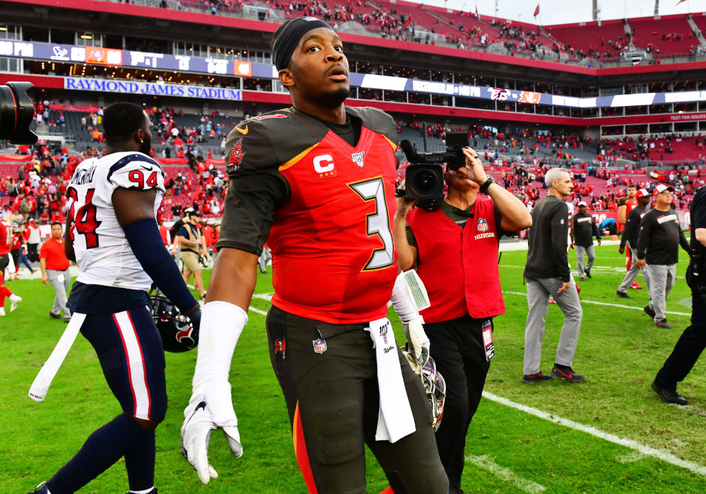 Jameis Winston walks off the field after losing to the Falcons