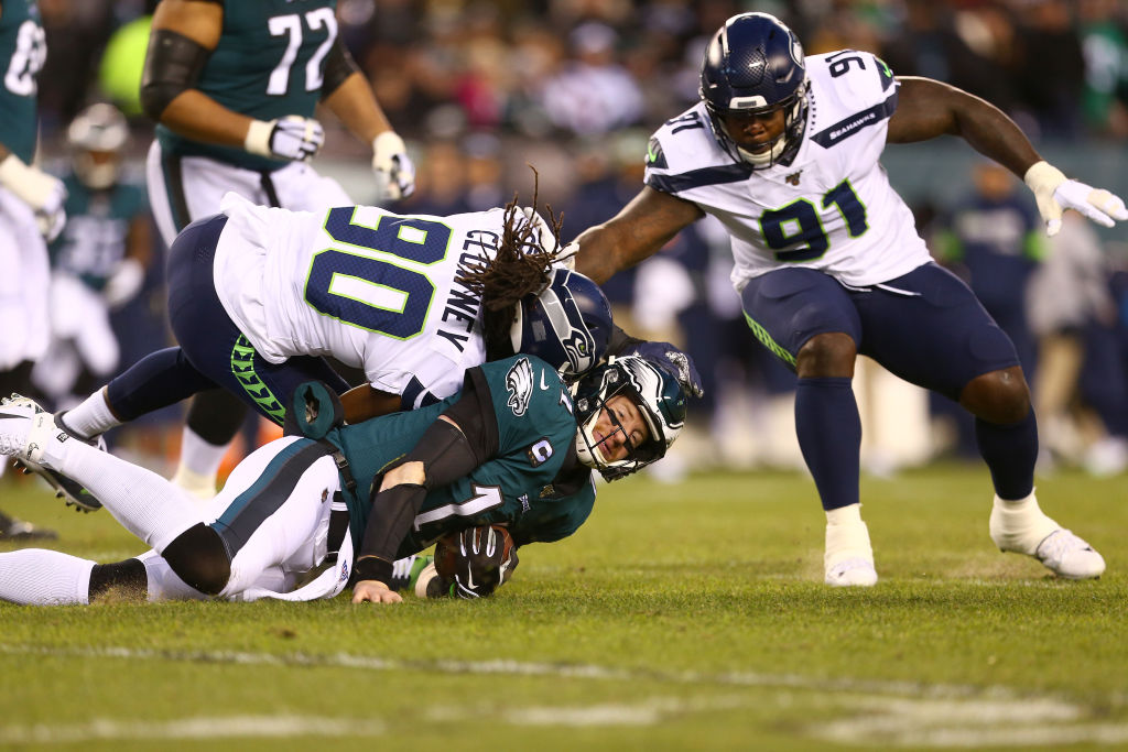 Quarterback Carson Wentz of the Eagles is hit by Jadeveon Clowney of the Seahawks