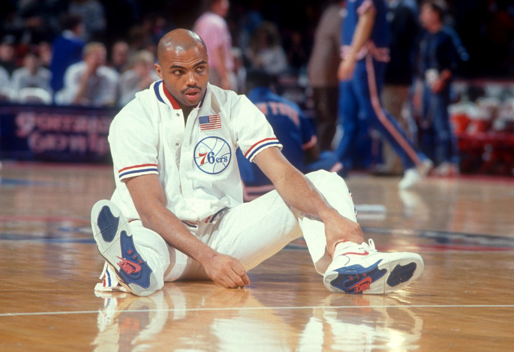 Charles Barkley stretching before a 76ers game