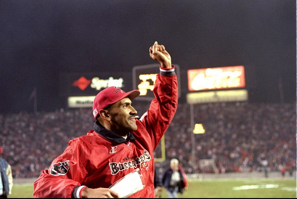 Coach Tony Dungy of the Tampa Bay Buccaneers waves to the crowd in 1997