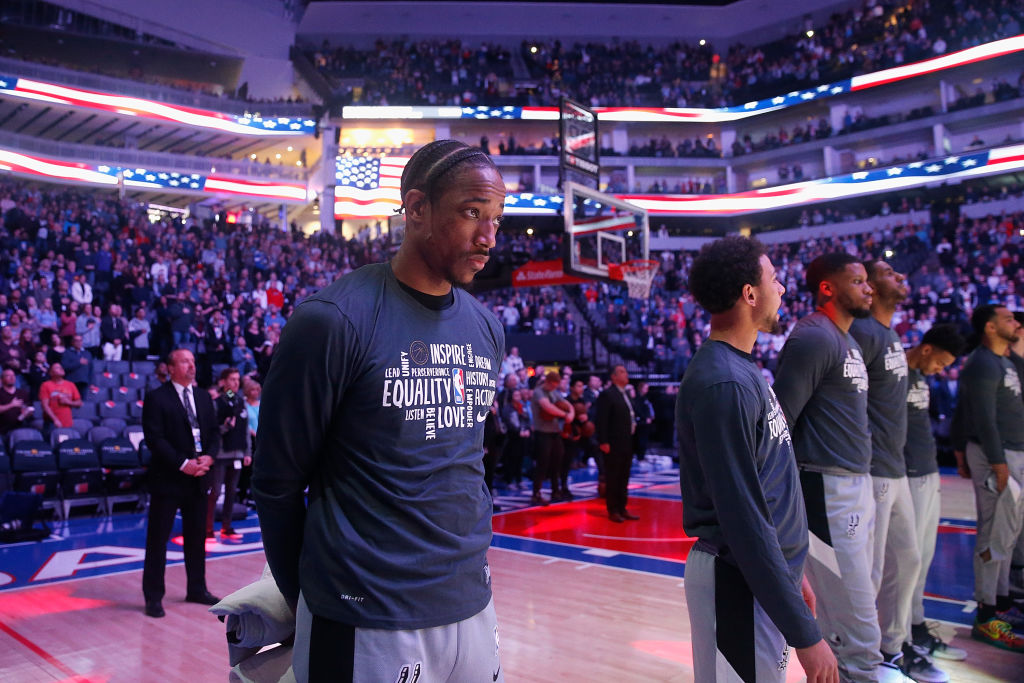 DeMar DeRozan of the San Antonio Spurs stands for the national anthem