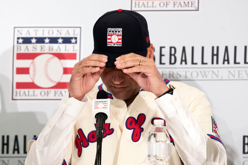 Derek Jeter puts on his Hall of Fame cap during the 2020 Hall of Fame Press Conference