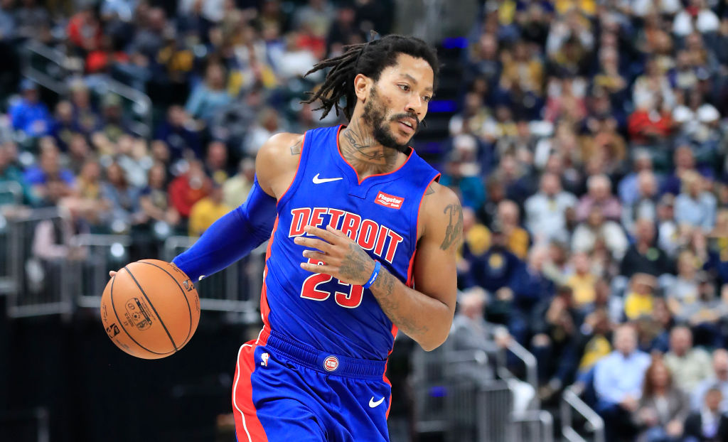 Derrick Rose taking the ball up the court for the Detroit Pistons