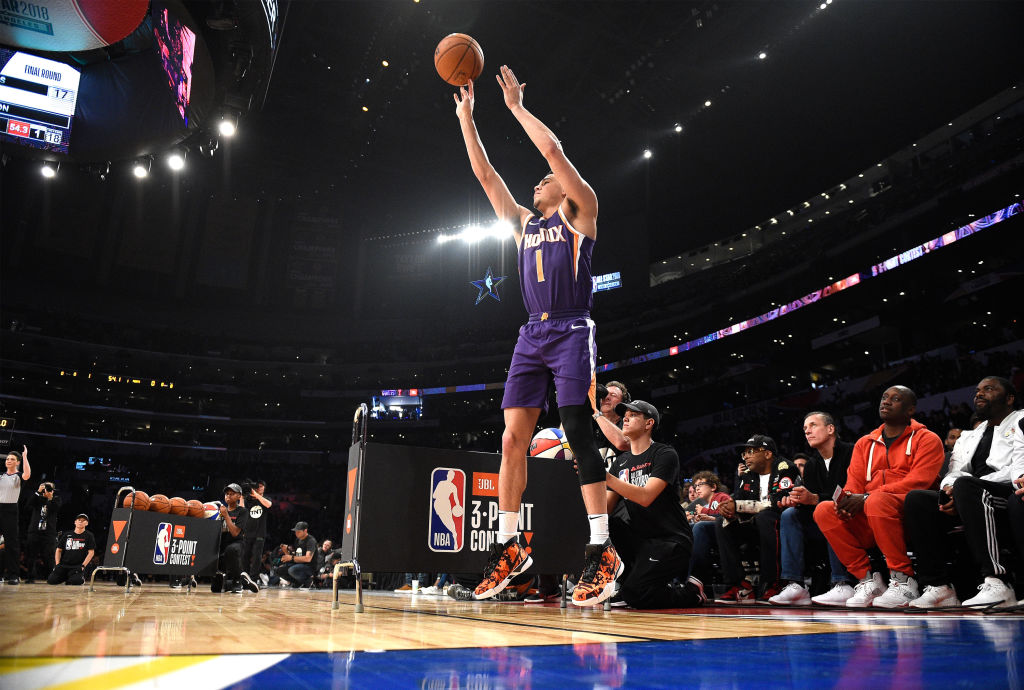 Devin Booker of the Phoenix Suns competes in the 2018 Three-Point Contest at Staples Center