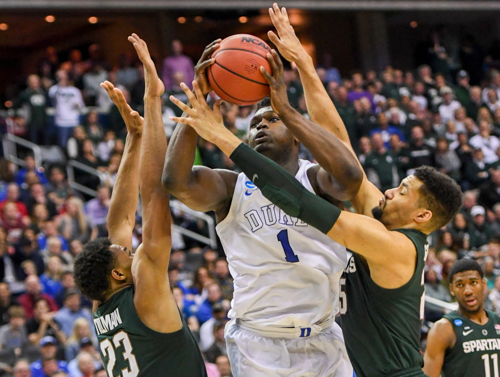 Duke Blue Devils forward Zion Williamson is double-teamed by Michigan State defenders Xavier Tillman and Kenny Goins
