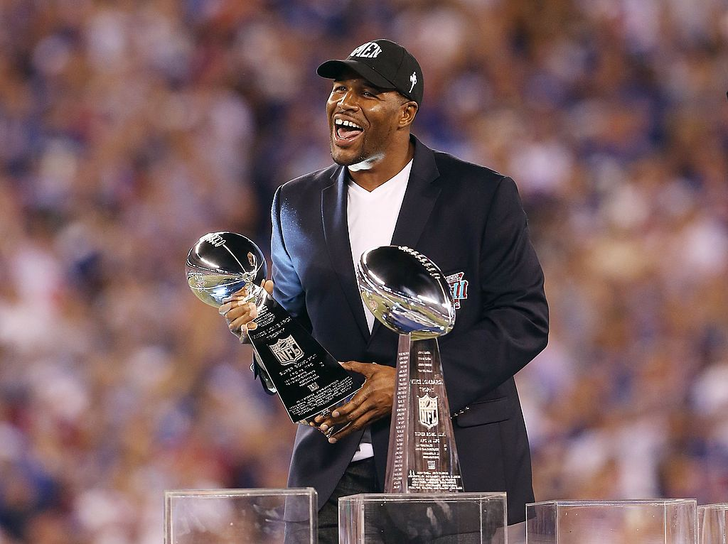 Former New York Giant Michael Strahan holds the Vince Lombardi trophy in 2012