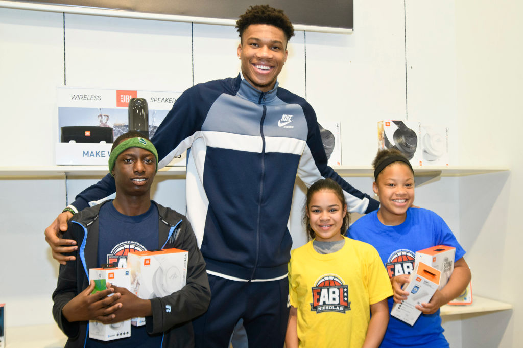 Giannis Antetokoumpo surprises (L-R) Andre Moore, Tatiana Edwards, and Joymarie Fernandez from the Boys And Girls Club in Milwaukee, Wisconsin