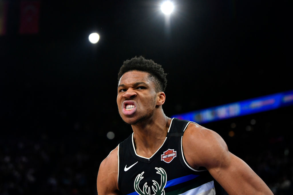 Giannis Antetokounmpo of the Milwaukee Bucks reacts after a dunk
