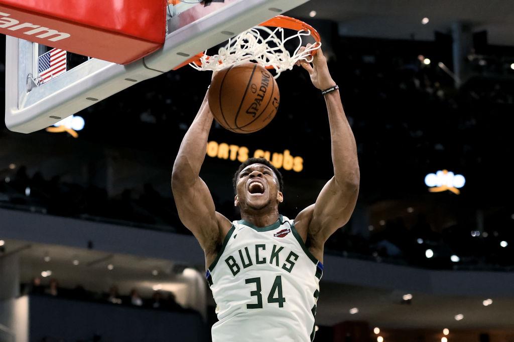 Giannis Antetokounmpo of the Milwaukee Bucks dunks the ball