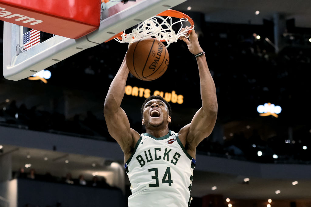 Giannis Antetokounmpo of the Milwaukee Bucks dunks the ball