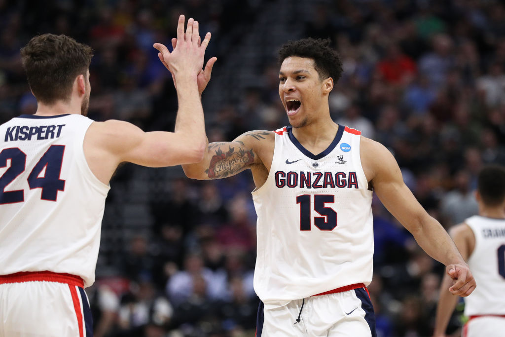 Players from Gonzaga's basketball team celebrate a point