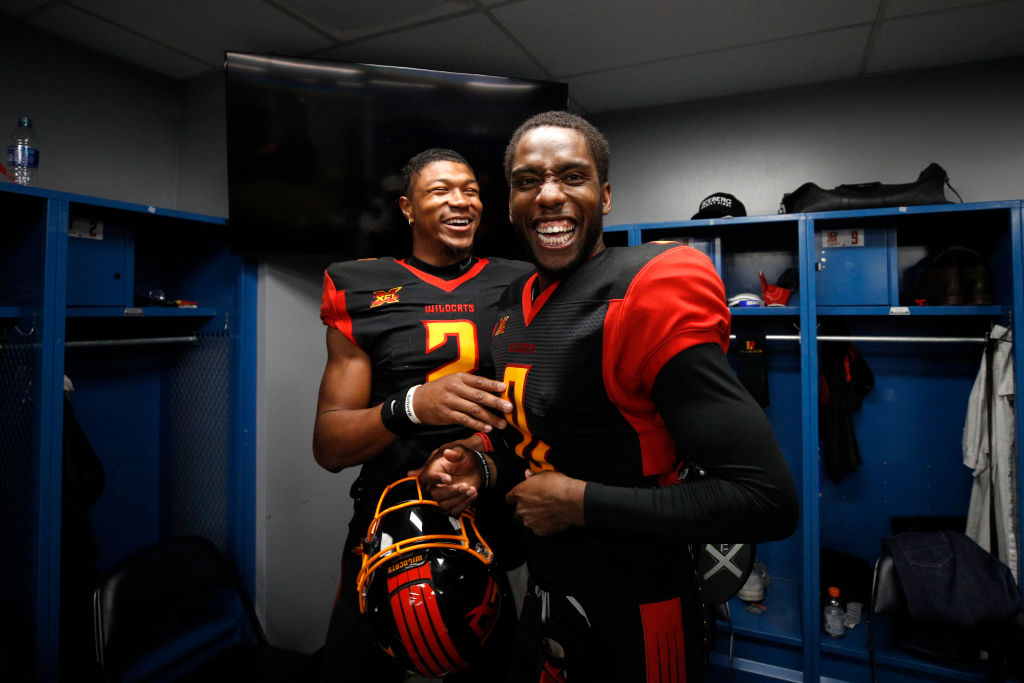 Jalan McClendon and Josh Johnson of the LA Wildcats smile after an XFL game