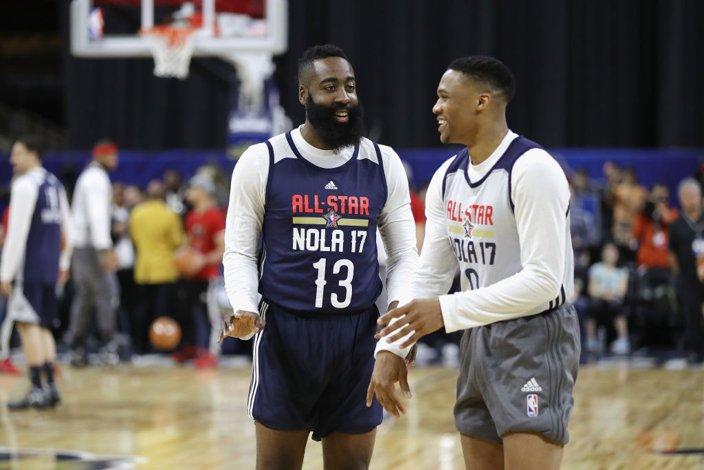 James Harden talks with Russell Westbrook during practice for the 2017 NBA All-Star Game