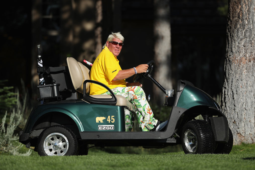 John Daly drives a cart in 2019