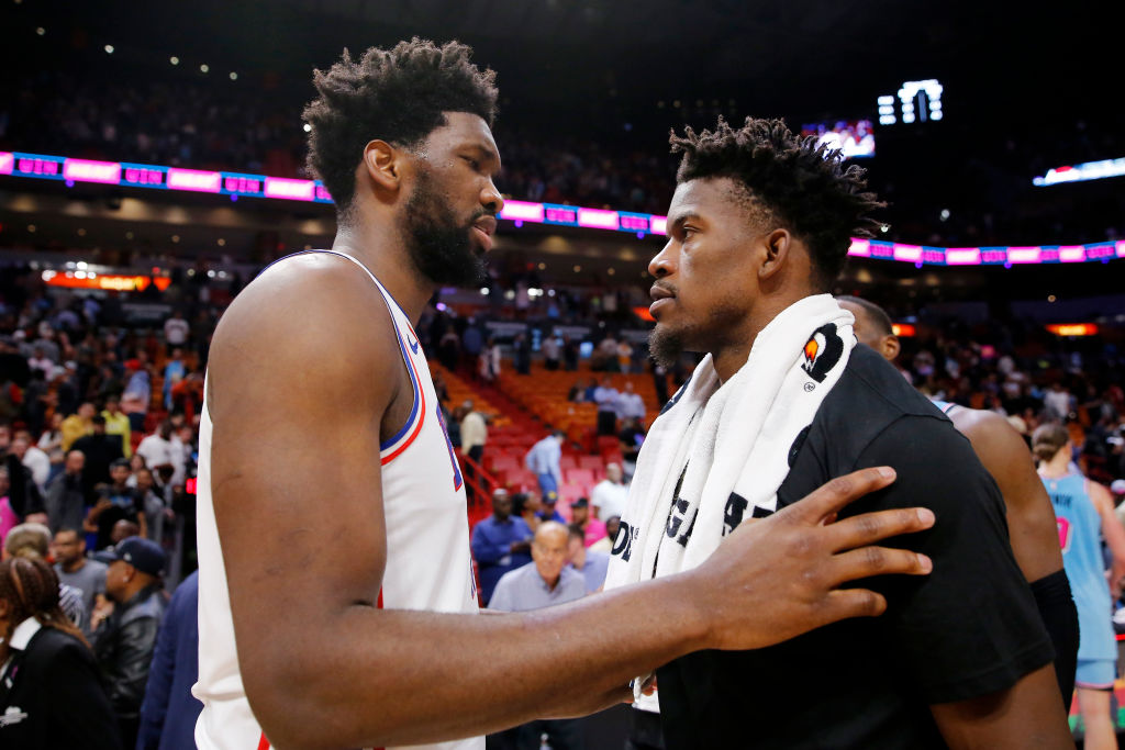 Joel Embiid and Jimmy Butler talk at midcourt