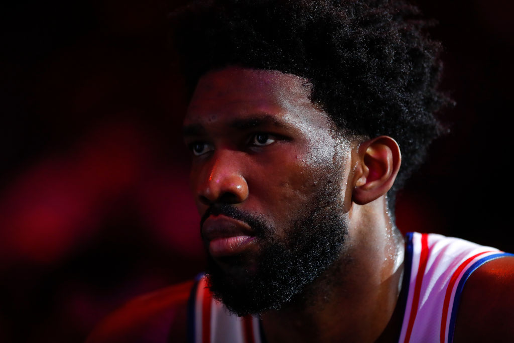 Joel Embiid of the Philadelphia 76ers watches on during a timeout