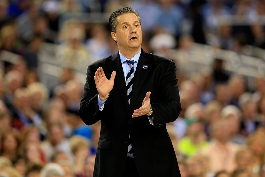 John Calipari yelling to his team from the sidelines during a game