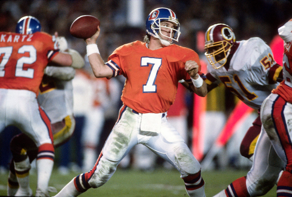 John Elways throwing a pass against the Washington Redskins
