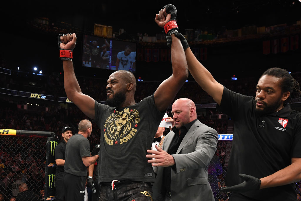 UFC fighter Jon Jones celebrates his victory in the octagon.