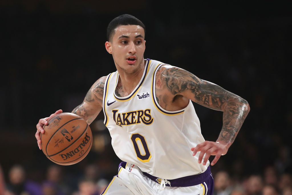 Kyle Kuzma dribbles up the court for the Lakers