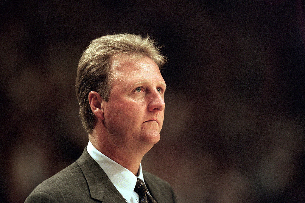 Larry Bird in a suit coaching a basketball game