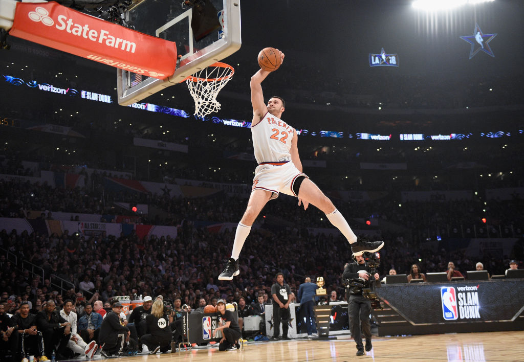 Basketball player Larry Nance Jr. competes in the NBA Slam Dunk contest while wearing his dad's No. 22 jersey.