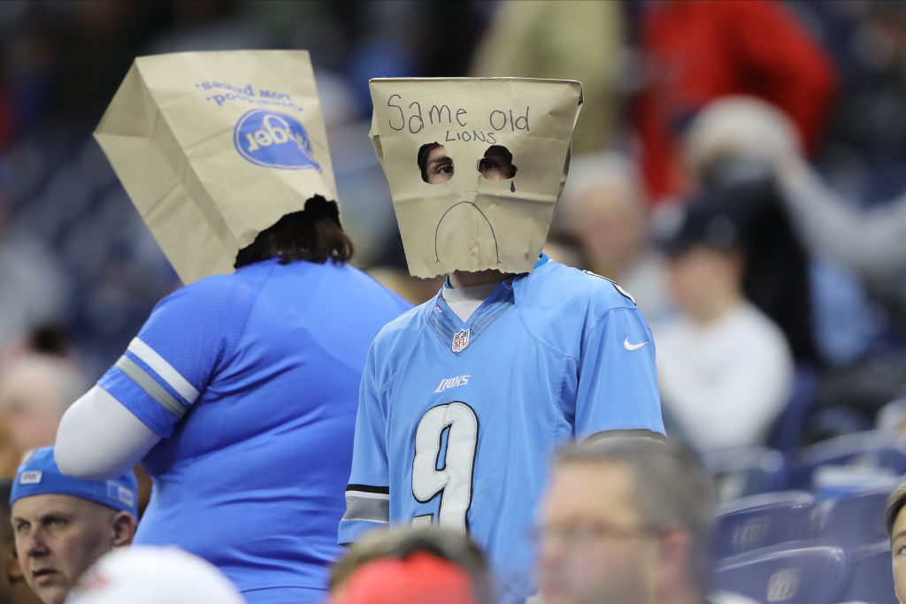 A Lions fan wearing a paper bag over their head at a game