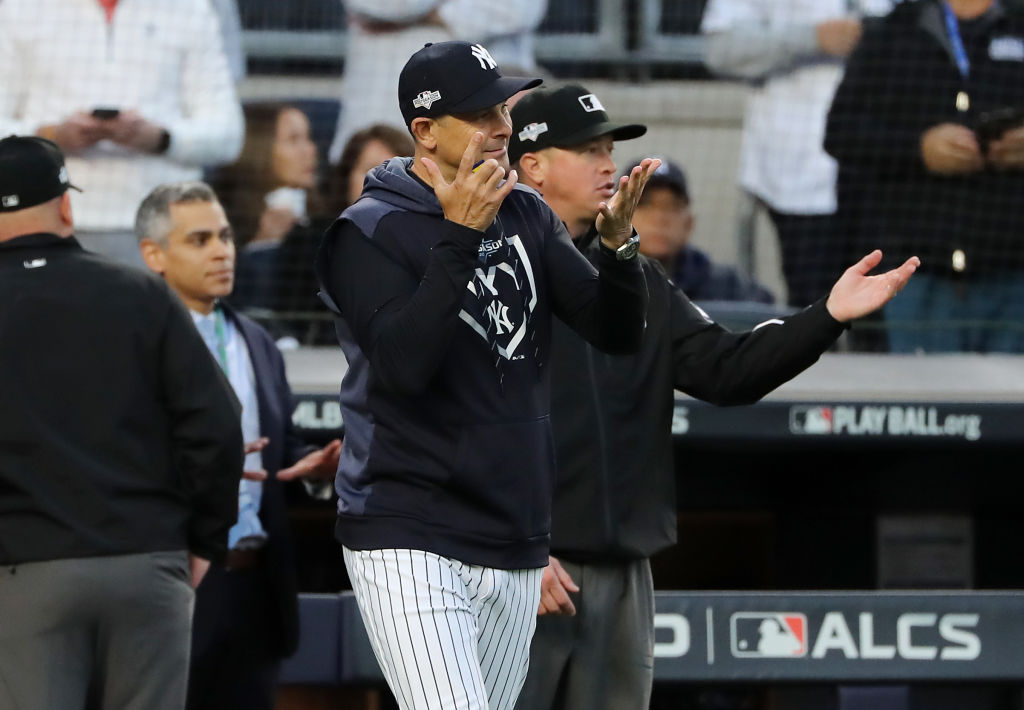 Manager Aaron Boone of the New York Yankees reacts as the home plate umpire is replaced