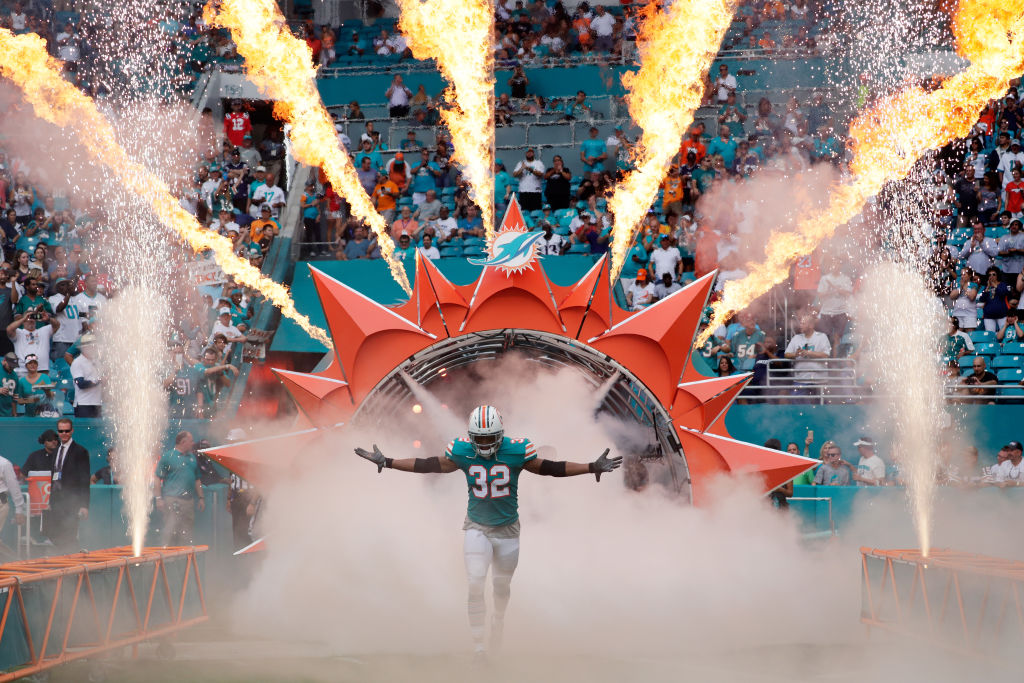 A Miami Dolphins player runs out of the tunnel