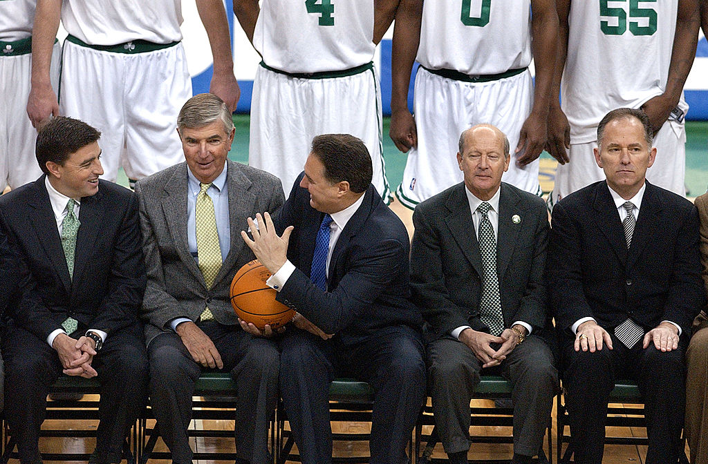 Prior to a Celtics team photo, the owners sit on the bench