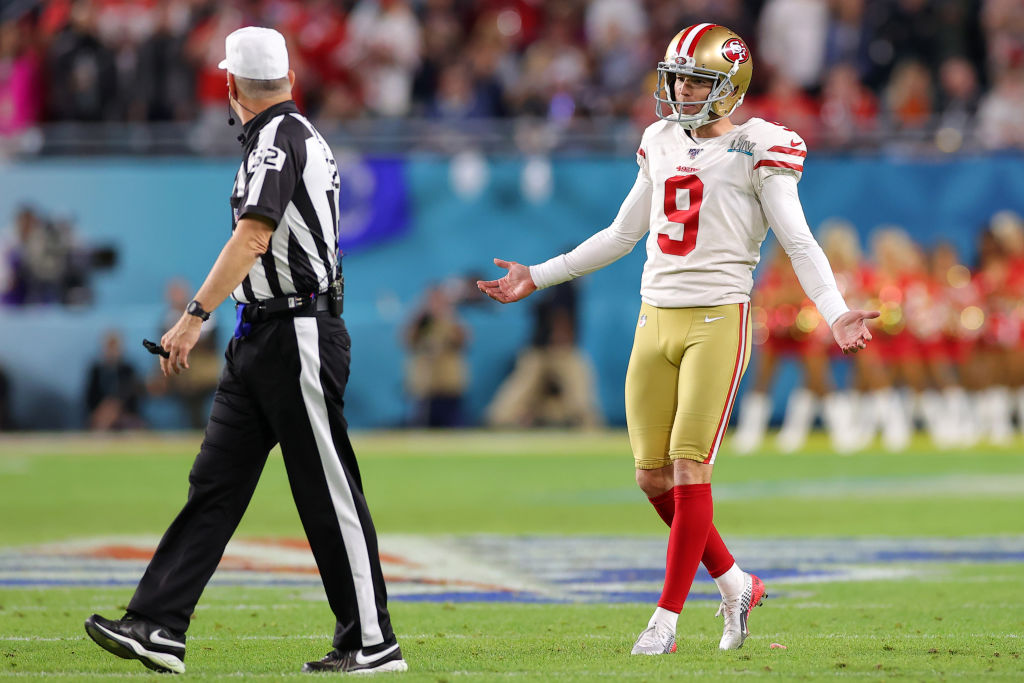 A player for the 49ers arguing with an NFL referee