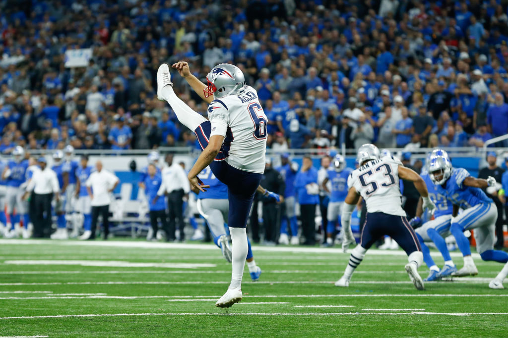 New England Patriots punter Ryan Allen punts the ball during a 2018 game
