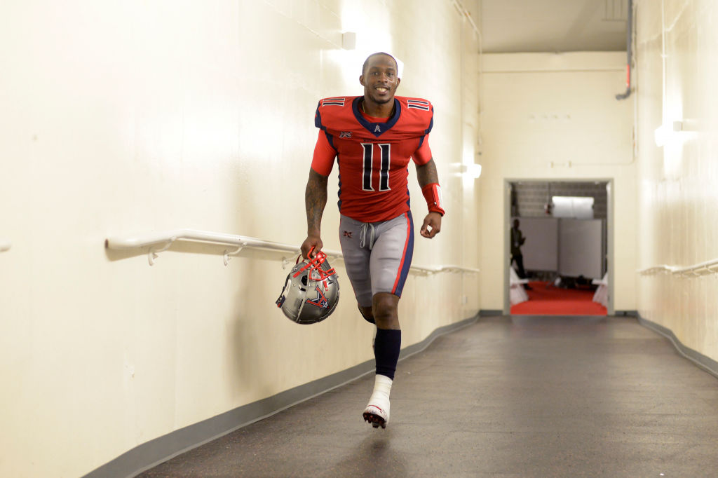 P.J. Walker of the Houston Roughnecks runs back to the locker room after a game