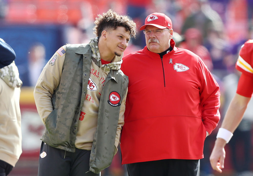 Patrick Mahomes of the Kansas City Chiefs talks with head coach Andy Reid before a 2019 game
