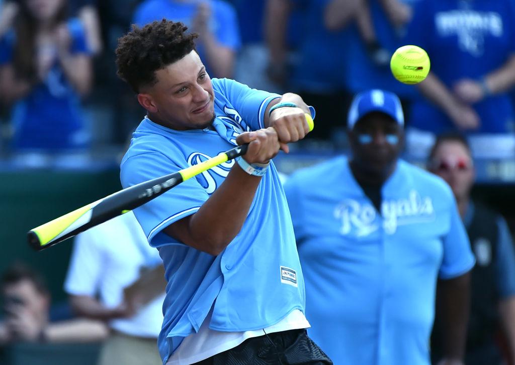 Patrick Mahomes swinging at a softball