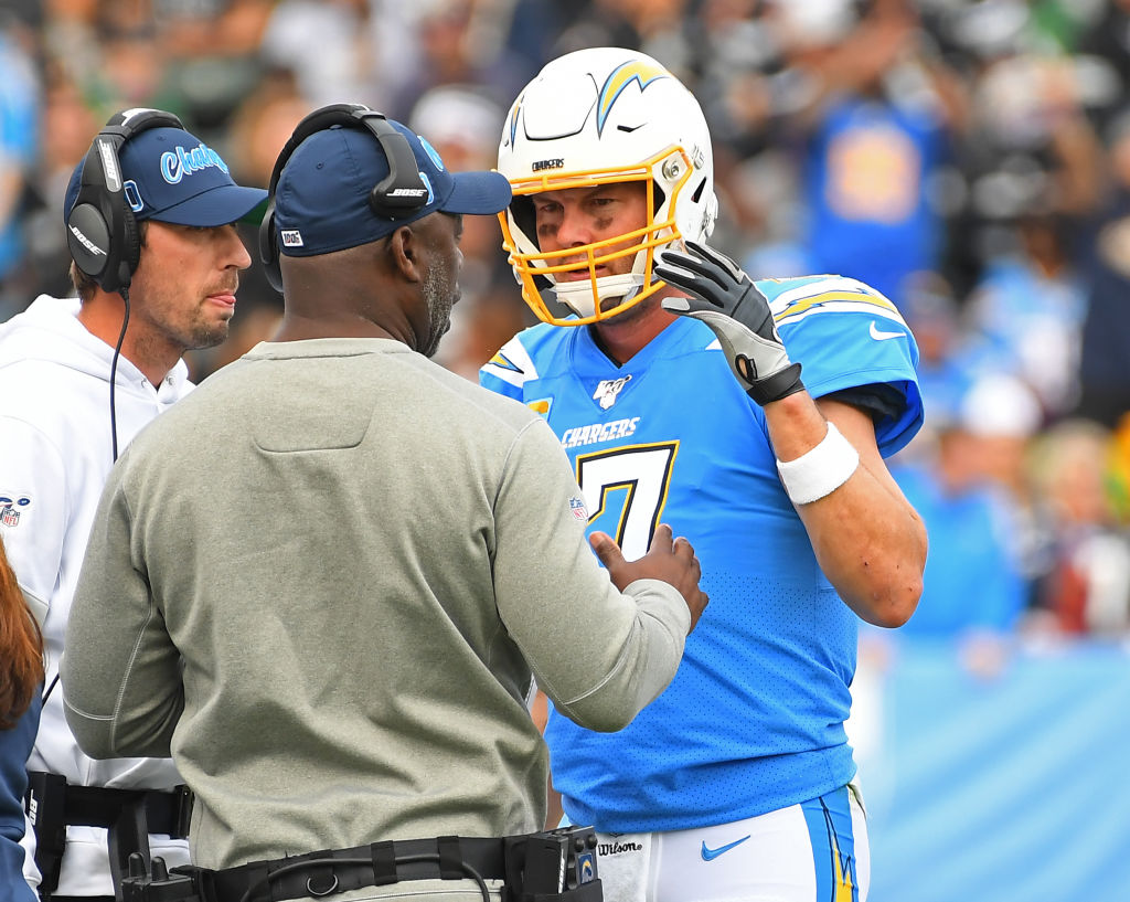 hilip Rivers and Anthony Lynn talk on the sideline