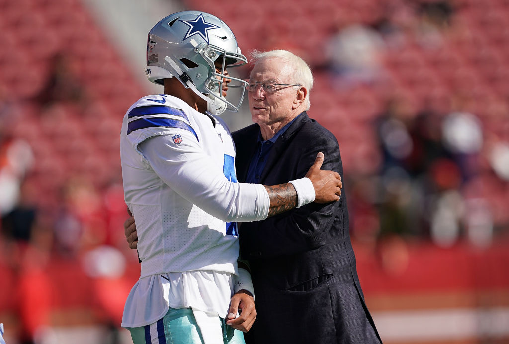 Quarterback Dak Prescott and team owner Jerry Jones of the Dallas Cowboys hug each other